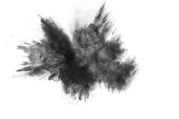 Defocused image of black powder paints against white background