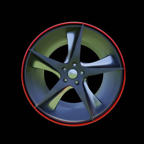 Close-up of wheel against black background