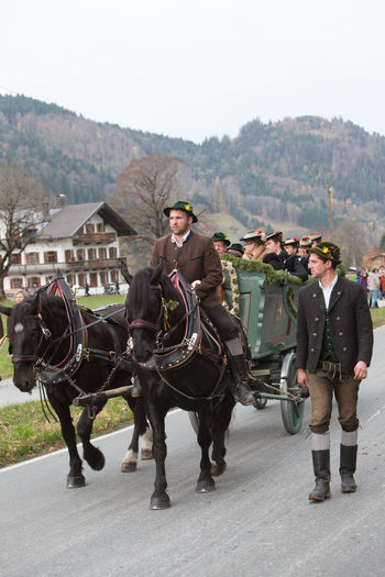 Schliersee, Bavaria - November 5, 2017: Every year on the 1st Sunday in November, the Idyllic Horse procession, named Leonhardi in Bavarian Schliersee takes place in commemoration of Patron St. Leonhard. In traditional clothing and decorated horse-drawn carriages horses and riders move to the church of St. Leonhard Bavaria Church Leonhard Ride Leonhardi Patron St. Leonhard Rider ST.Leonhard Schliersee Traditional Clothing Bodice Boys Cart Coustume Cultures Decorated Dirndl Girls Horse Horse Carts Horse Procession Idyllic Leather Pants Men Schalk Women