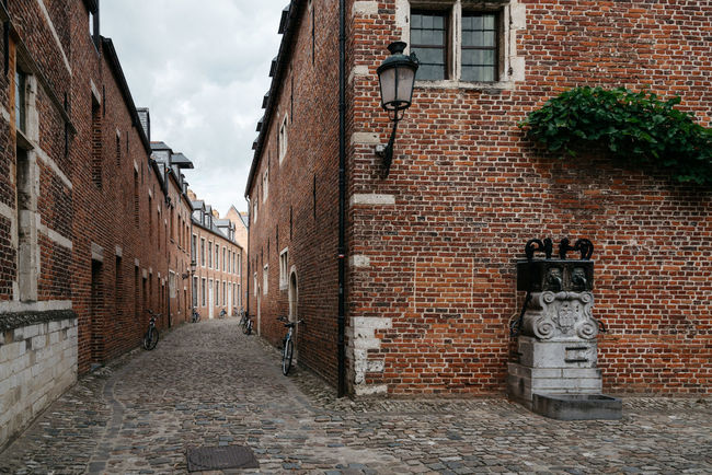 Beguinage in Leuven Alley Architecture Beguinage Belgium Brick Wall Building Exterior Built Structure Campus Campus Life Cobblestone Empty Historical Leuven Louvain No People Old Street Student Life Tourist Attraction  Neighborhood Map Travel Travel Destinations University University Campus World Heritage Site