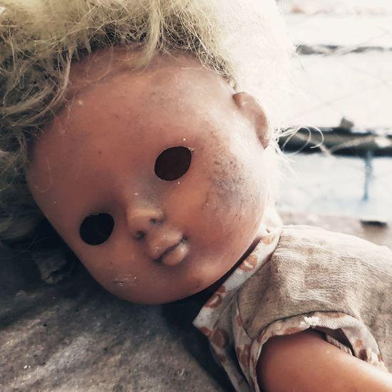 Close-up of broken doll