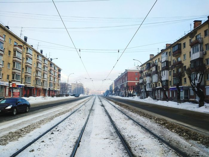 Cold Temperature Winter Railroad Track Weather Mode Of Transport Snow Building Exterior Outdoors Sky Public Transportation City Rail Transportation Transportation Architecture Day No People Built Structure