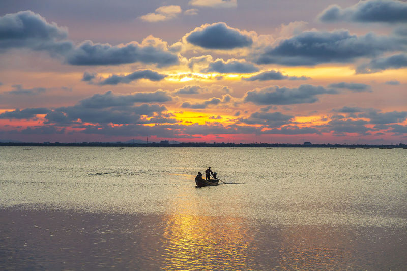 Silhouette of a local fishing boat at the sea in yaring district, pattani, thailand