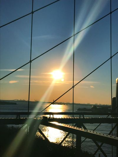 Sun Sunset Water Sky Reflection Sunlight Sunbeam Nature Sea Railing Scenics Outdoors Beauty In Nature No People Bridge - Man Made Structure Connection Architecture Brooklyn Bridge / New York Day