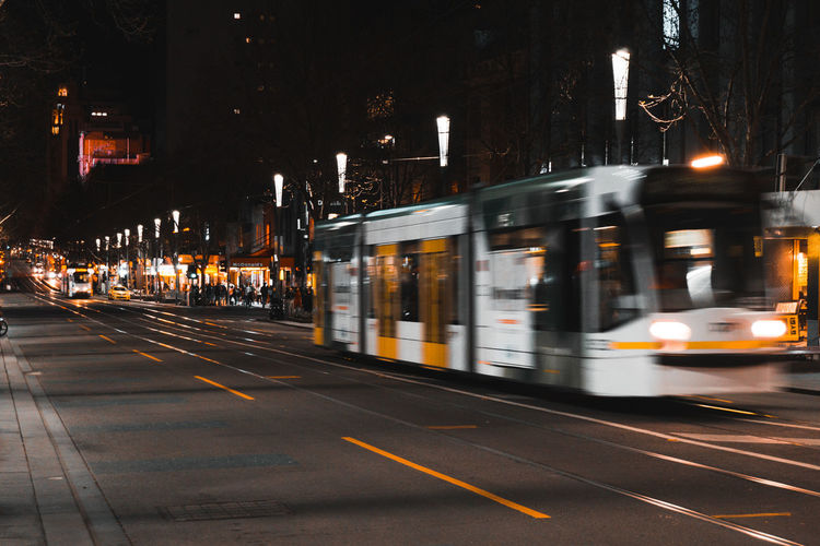 Architecture Blurred Motion Building Exterior Built Structure Cable Car City City Life Illuminated Land Vehicle Mode Of Transportation Motion Night No People on the move Outdoors Public Transportation Rail Transportation Road Speed Street Track Transportation