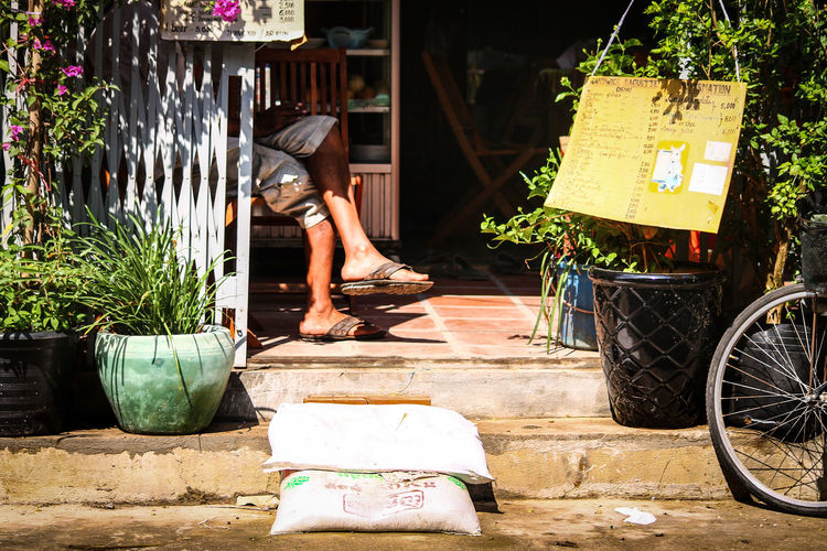 Sommergefühle Summer ASIA Sunlight Light And Shadows Bicycle Stationary Mode Of Transport Sitting Leisure Activity Street Photography Phnom Pehn, Cambodia Streets Of Cambodia Human Leg Relaxing Moments Street Life Summer In Cambodia Travel Coffee Shop Scene Afternoon Coffee Break Simple Life Lifestyle