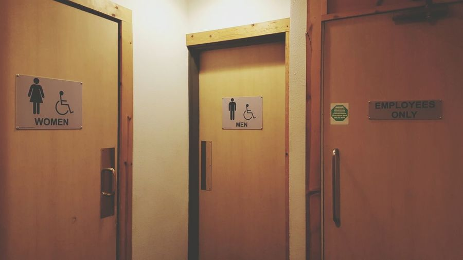 Female and male sign on door