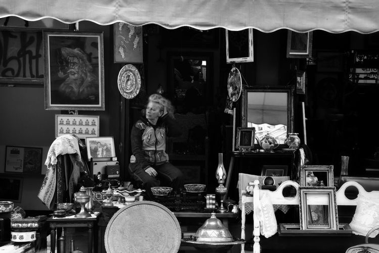 """""""Athens, February 2018"""" WomeninBusiness Blackandwhite Antique Antiques Retail  Retail Display Blackandwhite Photography Women Of EyeEm One Person One Woman Only Occupation Work EyeEm Gallery Eye4photography  Greece Old But Awesome The Week on EyeEm Athens, Greece Day"""