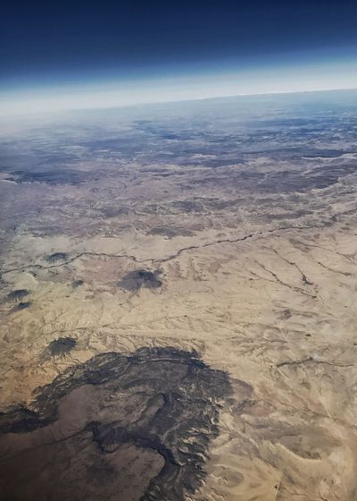 Rugged desert landscape. Vertical Curvature Of The Earth Rugged Landscape Western USA Desert Colors Desert Arid Landscape Geology Nature Outdoors Landscape Beauty In Nature Scenics No People Tranquility Aerial View Arid Climate Physical Geography Sky
