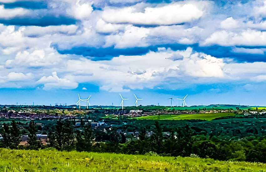 Fuel And Power Generation Wind Turbine Environmental Conservation Wind Power Alternative Energy Technology Cloud - Sky Business Finance And Industry Sustainable Resources Renewable Energy Field Outdoors Electricity  Agriculture No People Nature Rural Scene Green Color Day Sky
