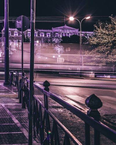 Street lights on bridge in city at night