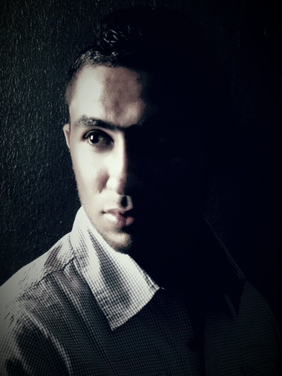 portrait, young adult, front view, one person, looking at camera, headshot, studio shot, well-dressed, real people, close-up, black background, indoors, one man only, only men, day, people, adult, adults only