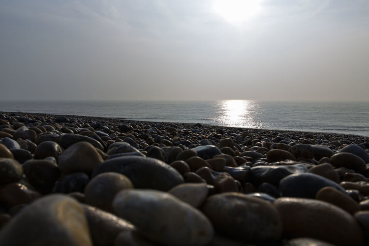 Beach by Dungeness, Romney Marsh, England, United Kingdom Beach Beauty In Nature Close-up Day Horizon Over Water Nature No People Outdoors Pebble Pebble Beach Scenics Sea Sky Sunset Surface Level Tranquil Scene Tranquility Water