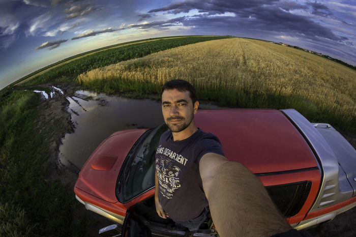 Agricultural Land Agriculture Photography Casual Clothing Cereals Clouds And Sky Fisheye Fun L200 Lifestyles Mitshubishi Mode Of Transport Nature Portrait Rain Rainy Days☔ Relaxation Selfie Selfie Portrait Sky SUV