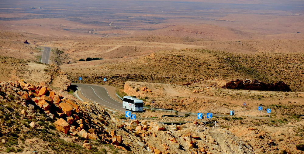 Road Desert Environment Landscape Transportation High Angle View Mode Of Transportation Scenics - Nature Land Vehicle Nature Land Day Mountain Motor Vehicle Beauty In Nature Non-urban Scene Car Highway Outdoors Plant Aerial View Semi-arid Climate Arid Climate It's About The Journey