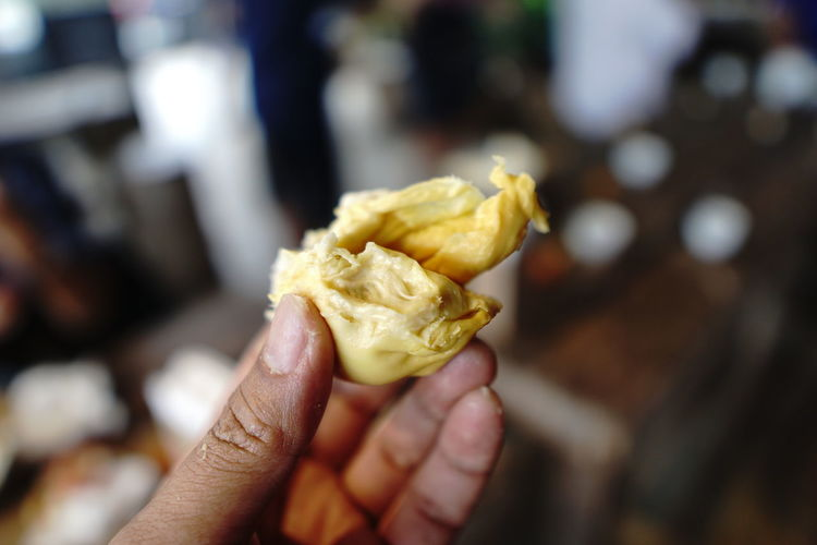 Sweet and aromatic durian fruit on your hand