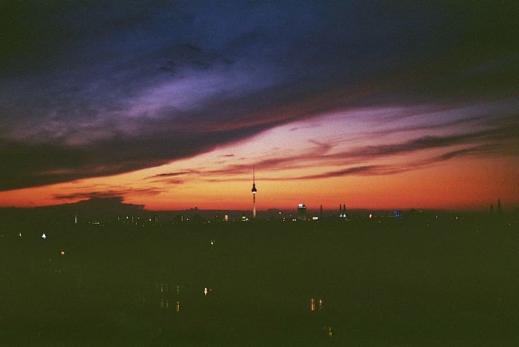 Analogue picture taken from a rooftop in Berlin during the summer. Berlin EyeEmNewHere Rooftop Architecture Beauty In Nature City No People Outdoors Silhouette Sky Sunset Tranquility Discover Berlin