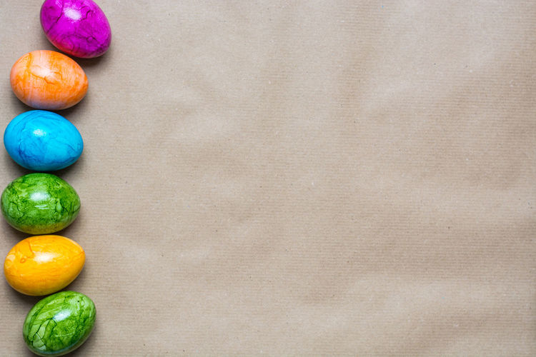 Directly above shot of multi colored eggs on table