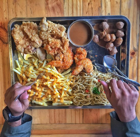 High angle view of person eating food