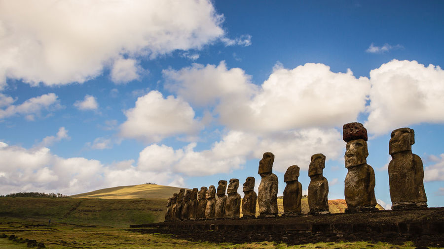 Ancient Statues On Field Against Sky