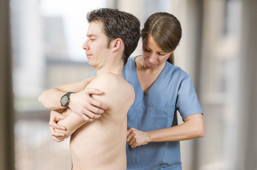 Physiotherapist, chiropractor doing cervical manipulation with axial compression in a clinic. Back Doctor  Man Medicine Pain Therapy Woman Cervical Chiropractor Clinic Healthcare And Medicine Injury Manipulation Massage Medical Muscles Muscular Patient person Physiotherapy Professional Stretching Therapist