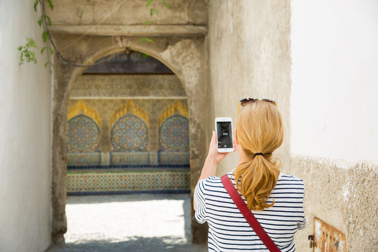 Technology Photographing Mobile Phone Women Rear View Camera Smart Phone Adult Tangier MoroccoTrip Morocco Morocco Travel Travel Destinations Travel Female Female Traveler Traveler