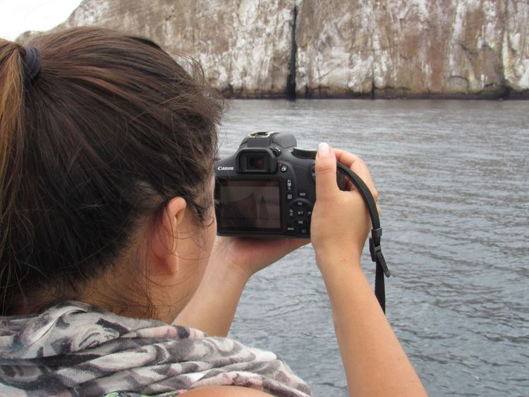 Photographer capturing the kicker rock Photographing Photography Themes Rear View One Person Camera - Photographic Equipment Real People Technology Sea Water Outdoors People Day Digital Single-lens Reflex Camera Adult An Eye For Travel