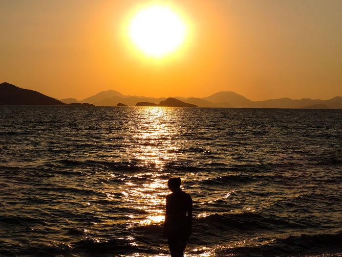 Thoughtful sunset Sunny EyeEmNewHere Eyeemphotography Water Sea Sunset Beach Horizon Wave Standing Silhouette Summer