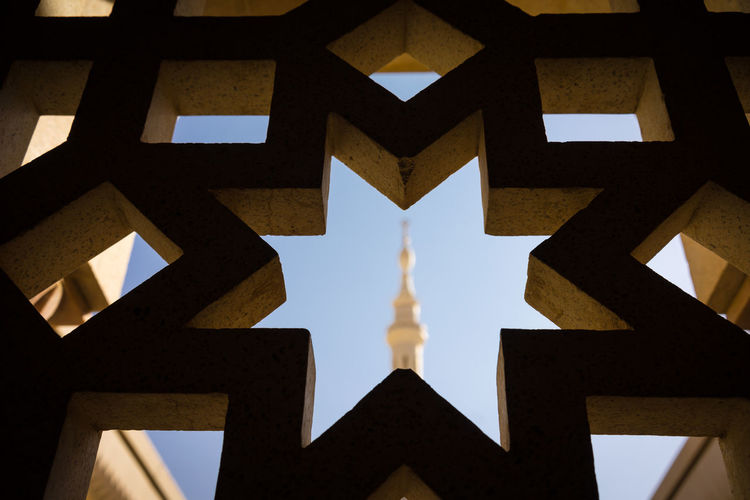 MEDINA, SAUDI ARABIA - 16TH NOV 2017; View of minaret in Mosque Al-Nabawi of Medina. It is the second-holiest site in Islam and the mosque was built by Prophet Muhammad in 622. Medina Al Munawarah Nabawi Mosque Pray Architecture Building Exterior Built Structure Close-up Day History Low Angle View Minaret Muslim No People Outdoors Sky