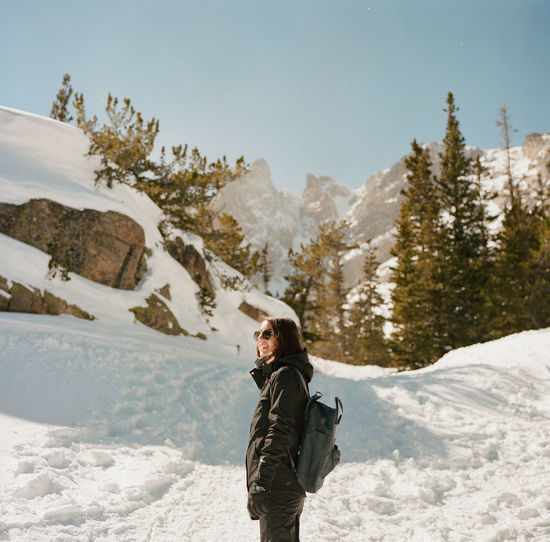 Estes Park, CO Film Portra 400 Beauty In Nature Clothing Cold Temperature Day Extreme Weather Hasselblad Leisure Activity Lifestyles Mountain Nature One Person Outdoors Real People Scenics - Nature Sky Snow Snowcapped Mountain Standing Three Quarter Length Warm Clothing Winter Young Adult