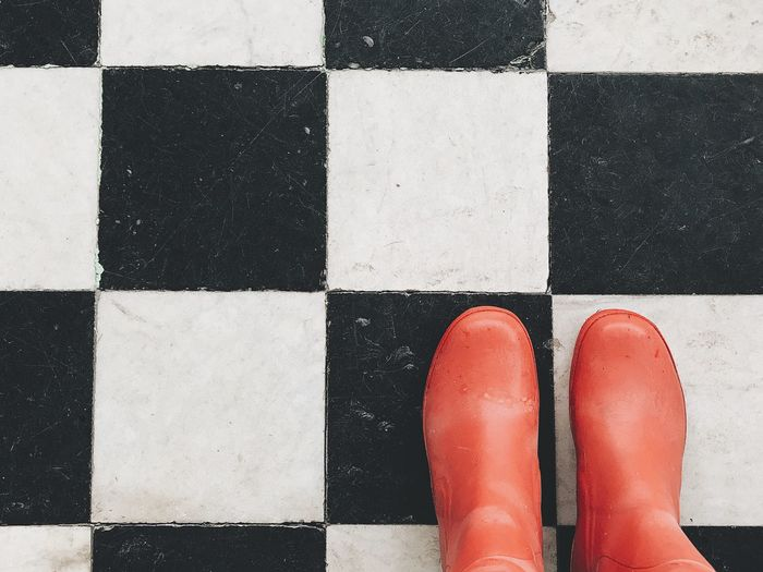 Human Leg Low Section Checked Pattern Full Frame One Person Day Human Body Part Close-up Outdoors People Minimalism Interior Design Home Interior Indoors  No People Standing Red Color Still Life Backgrounds Floor Classical Boots Rubber Boots Built Structure