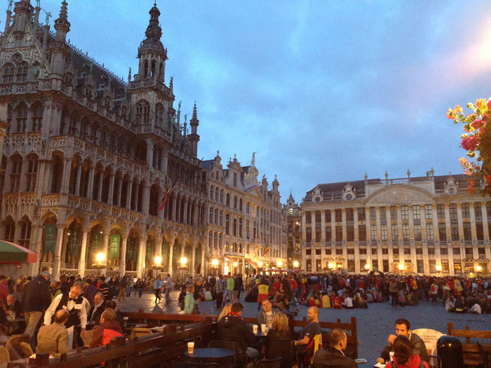 Grand Place Brussels on the evening of an international football batch Brussels Europe Capital Cities  Grand Place Grand Place Bruxelles Grand Place Brussels Building Exterior Architecture Group Of People Crowd Built Structure Large Group Of People Real People Illuminated City Travel Destinations Tourism Travel Men Women Sky Adult Nature Leisure Activity Tourist
