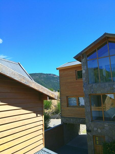 Bello y hermoso lugar! Built Structure Architecture Window Blue Building Exterior No People Sky Roof Day Outdoors Nature Sanmartindelosandes Vacations Lovelovelove Relaxing Happy Nature Tranquility Neuquen Happyday Vacaciones🌴