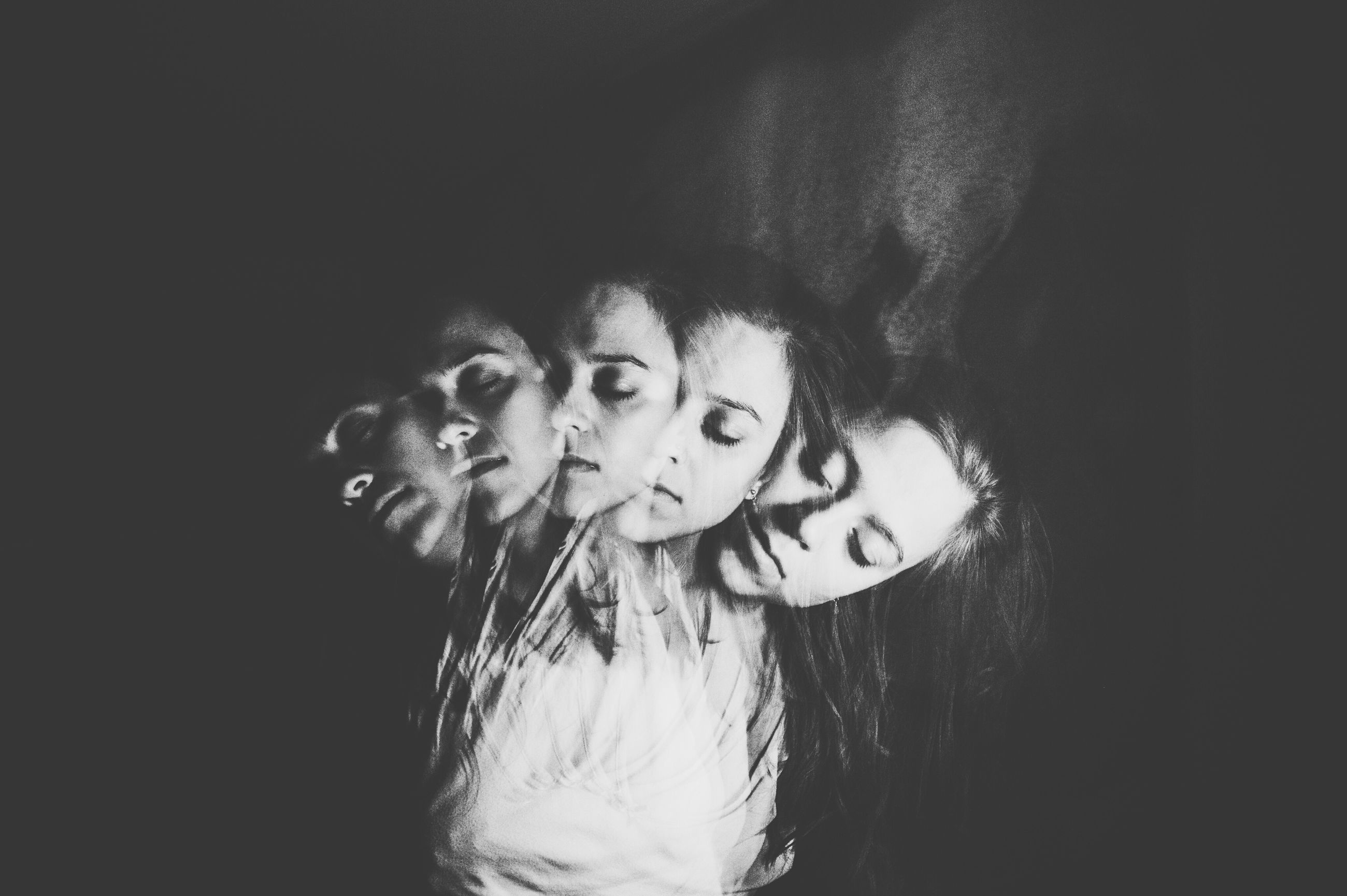 real people, happiness, studio shot, night, leisure activity, lifestyles, indoors, togetherness, smiling, looking at camera, young adult, young women, childhood, standing, bonding, black background, friendship, close-up