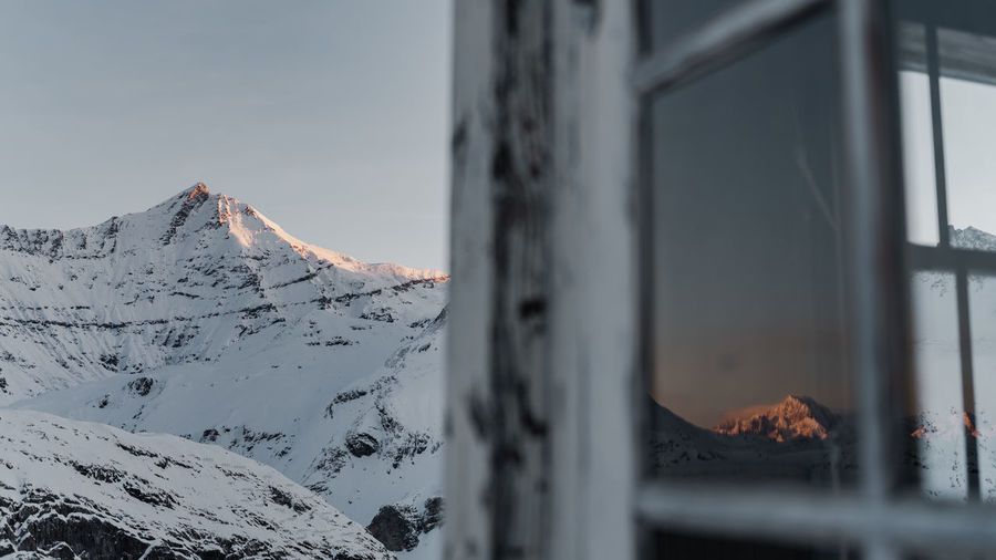 Close-up of snowcapped mountain against sky