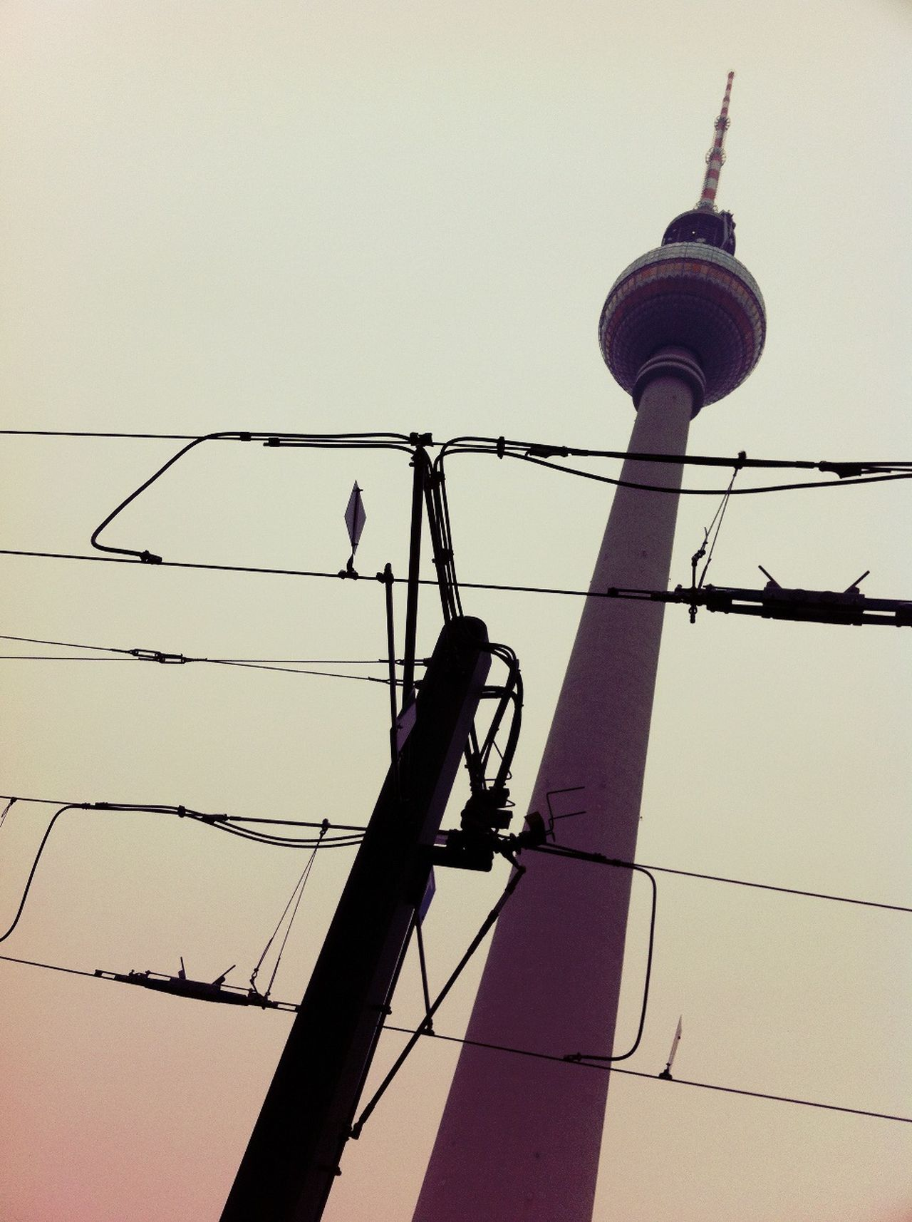 Low angle view of telephone pole and fernsehturm