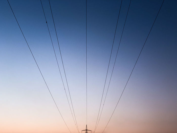 iPhone crop The Graphic City Cable Clear Sky Connection Day Electricity  Electricity Pylon Fuel And Power Generation Gradiented Sky Lines And Shapes Low Angle View Minimal Minimalism Minimalobsession Nature No People Outdoors Parallel Power Line  Power Supply Silhouette Sky Sunset Technology Telephone Line Vapor Trail Colour Your Horizn The Great Outdoors - 2018 EyeEm Awards