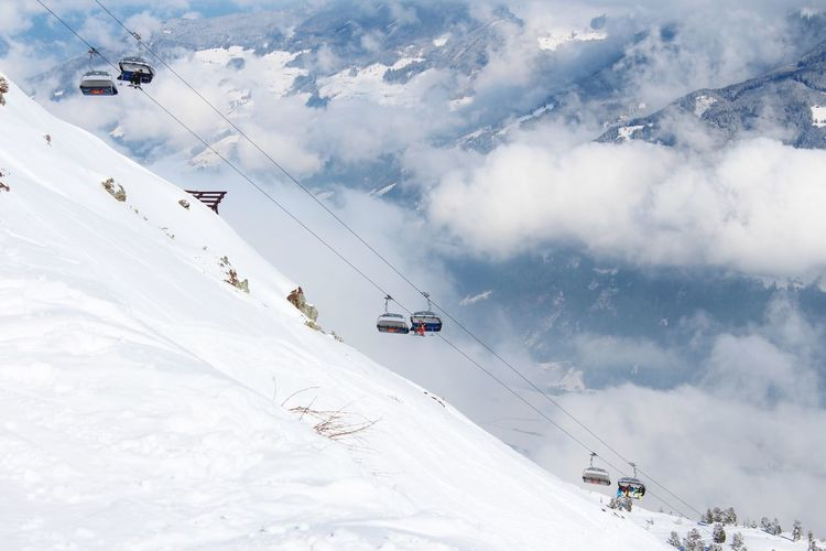 Low angle view of ski lift against mountains