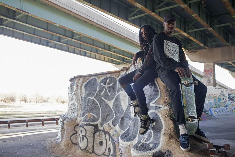 People sitting on bridge