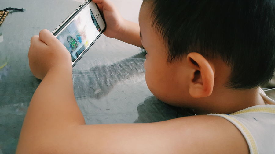 Close-up of child using a smart phone