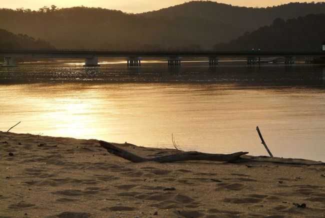 Australian Landscape Beauty In Nature Bridge - Man Made Structure Driftwood Golden Hour Idyllic Mogareeka Mountain Mountain Range Nature Nature No People The Great Outdoors - 2016 EyeEm Awards Orange Color Outdoors Remote Scenics Serenity Sky South Coast NSW Sunset Tathra Tranquil Scene Tranquility Water