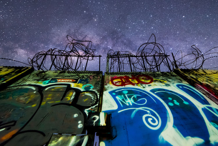 Architecture Art And Craft Astronomy Blue Built Structure Creativity Galaxy Graffiti Low Angle View Milky Way Multi Colored Mural Nature Night No People Outdoors Scenics - Nature Sky Space Star Star - Space Text