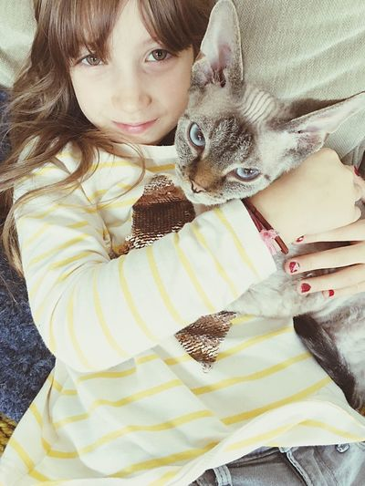 Portrait of girl with cat
