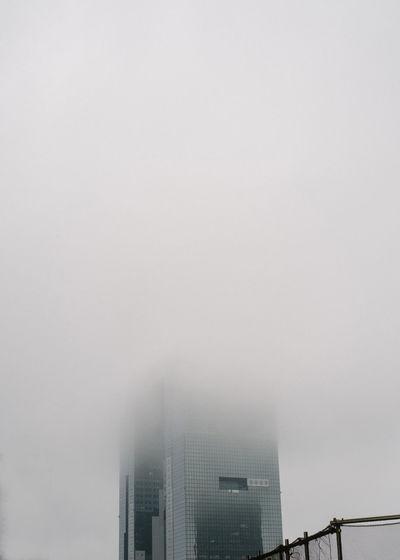 Fog in city against sky