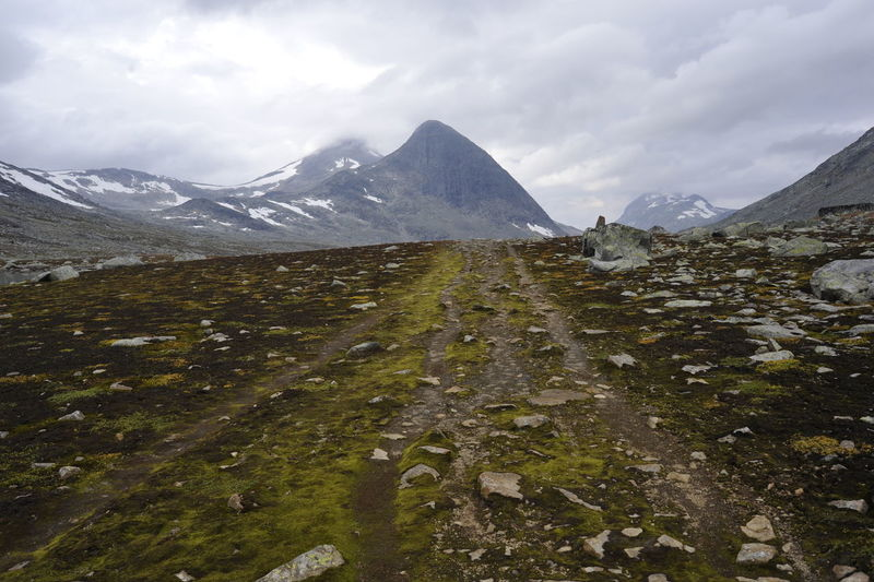 Scenic View Of Mountains Against Cloudy Sky At Jotunheimen National Park