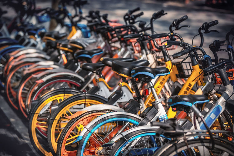 Close-up of bicycles in parking lot