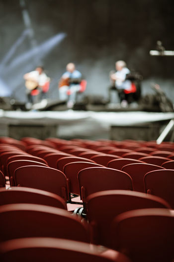 Concert Concert Photography Audience Audience Point Of View Point Of View Seat Seats Arts Culture And Entertainment Red In A Row Selective Focus Repetition Chair Empty Order Arrangement Absence Day Indoors  Large Group Of Objects Stage Side By Side Lines Pattern Music Event