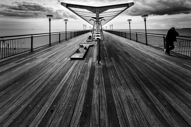 Disappearing Perspective Perspective Pier Architecture Boardwalk Photography Bridge Bridge - Man Made Structure Built Structure Cloud - Sky Connection Day Diminishing Perspective Direction Incidental People Nature Outdoors Railing Real People Sea Sky The Way Forward vanishing point Wood - Material Wood Paneling