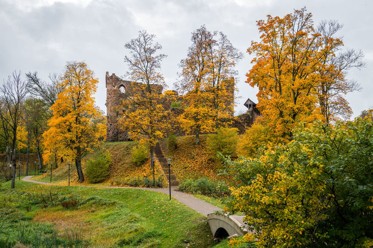 Dobele. Latvia. Autumn landscape with medieval castle ruins and river. Ancient Architecture Autumn Autumn colors Baltic Baltic Countries Castle Dobele Latvia Tree Ancient Architecture Baltic States Castle Ruin Castle Walls Clouds Day Fall Foliage History Medieval Nature No People Outdoors Scenics - Nature Sky