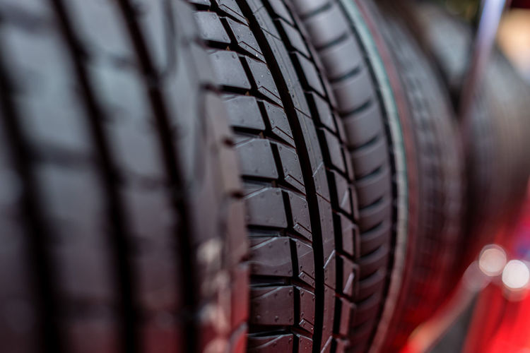 Tire stack background. Selective focus. Bicycle Black Color Car Close-up Consumerism Day Land Vehicle Man Made Man Made Object Metal Mode Of Transportation Motor Vehicle No People Pattern Retail  Rubber Selective Focus Sport Tire Transportation Wheel